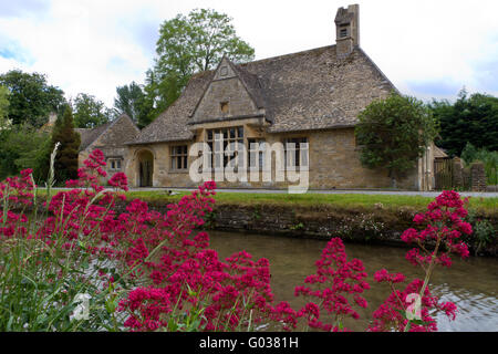 Cottage in Lower Slaughter, Cotswolds, UK - Stock Photo
