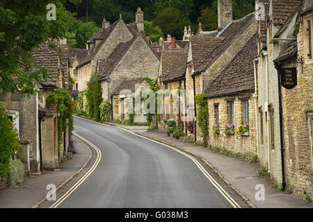 Cottages and main street in Castle Combe, Cotswold - Stock Photo