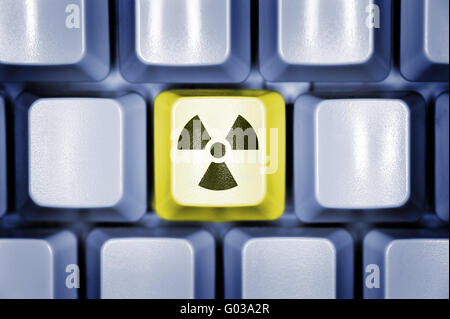 Computer keyboard with radioactivity sign - Stock Photo