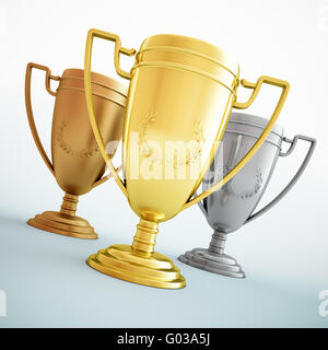Gold, silver and bronze - three shiny trophies. - Stock Photo