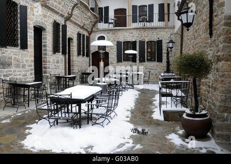 Empty Courtyard Restaurant in the Winter - Stock Photo