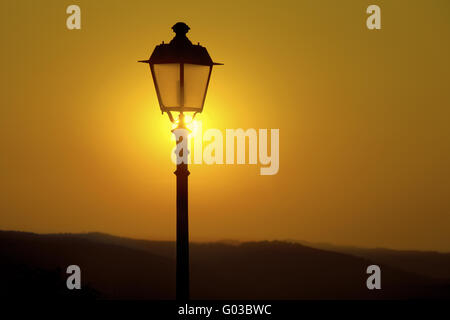 street lantern and sunset, Radda in Chianti, Italy - Stock Photo