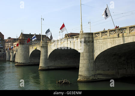 Flags of the Swiss cantons at a Rhine river bridge - Stock Photo