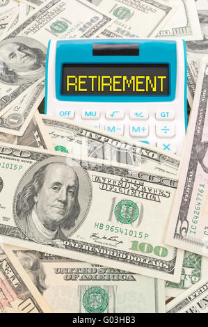 Retirement word on calulator with American notes - Stock Photo