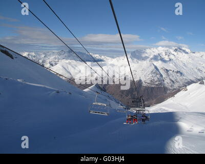 sunny alpine scene with chairlifts - Stock Photo