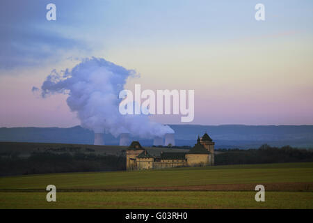 Malbrouck castle, cooling towers of nuclear plant - Stock Photo
