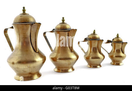 Four old fashioned style copper coffeepot isolated on white background - Stock Photo