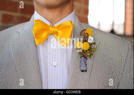 Seersucker Suit with yellow bowtie and boutonniere - Stock Photo