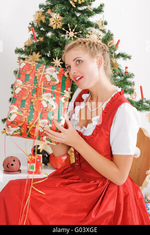 Young woman in traditional costume at christmas - Stock Photo