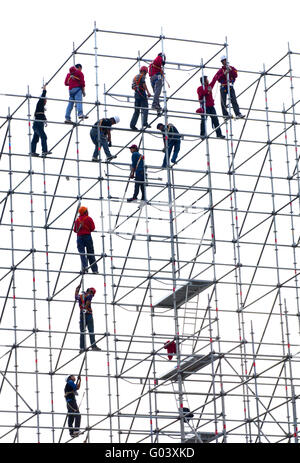 artistic workers on a high-rise scaffolding, Hong - Stock Photo
