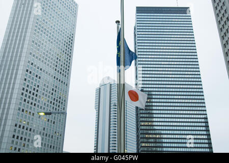 skyscrapers office buildings and Japanese state fl - Stock Photo