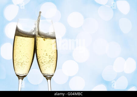 two glasses of sparkling wine with abstract lights - Stock Photo