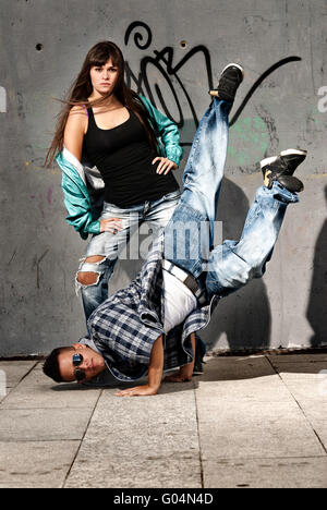 Young urban couple dancers hip hop dancing urban scene - Stock Photo