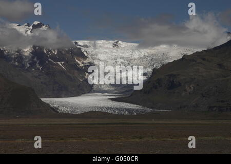 Svínafellsjökull is one of the outlet glaciers (glacier tongues) of the Vatnajökull ice cap. Skaftafell - Stock Photo