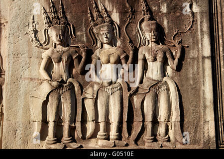 Bas-relief stone carvings of Apsaras, Angkor Wat (12th century Khmer temple), Angkor World Heritage Site, Siem Reap, - Stock Photo