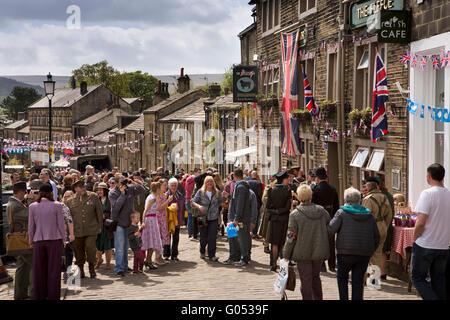 UK, England, Yorkshire, Haworth 40s Weekend, Main Street, visitors in costume outside Fleece Inn - Stock Photo