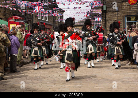 UK, England, Yorkshire, Haworth 40s Weekend, City of Bradford Pipe Band marching through village - Stock Photo