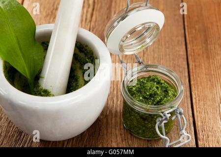 Homemade wild garlic pesto with fresh ingredients - Stock Photo
