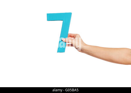 hand holding up the number seven from the right - Stock Photo