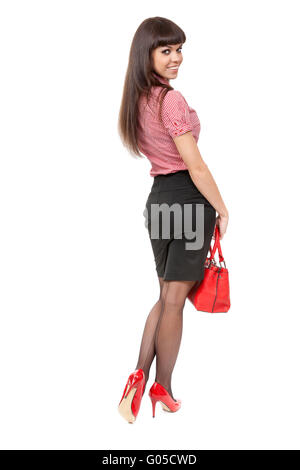Beautiful slim girl in high heel shoes with a stylish red bag in a studio full length - Stock Photo