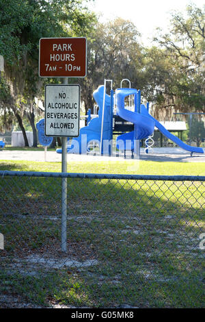 No Alcoholic beverages allowed sign beside a children's playground in Loughman, Davenport, Florida, USA. April 2016 - Stock Photo