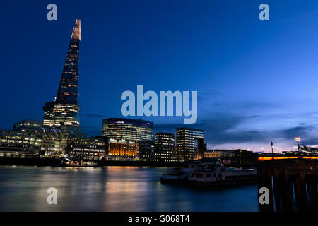 Sunset on the London skyline showing The Shard and Thames - Stock Photo