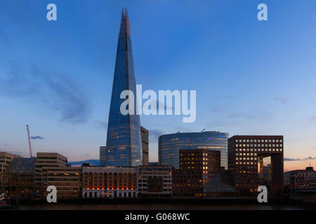 Sunset on the London skyline showing The Shard and office buildings - Stock Photo
