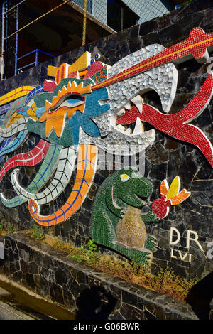 Diego Rivera designed tiled mosaic mural (Ehecatl-Calle) along the street in front of the Dolores Olmeda home in - Stock Photo