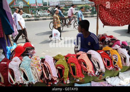 Dhaka, Bangladesh. 30 April, 2016.  A vendor waits for customer on a hot summer Day in the capital Dhaka on 30 April, - Stock Photo
