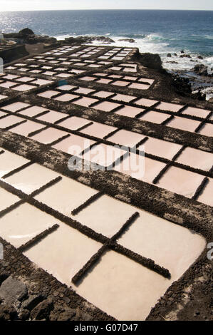 salt pan pans saltpan saltpans  Salinas Marinas de Fuencaliente de la Palma evaporation water evaporated sea lake - Stock Photo