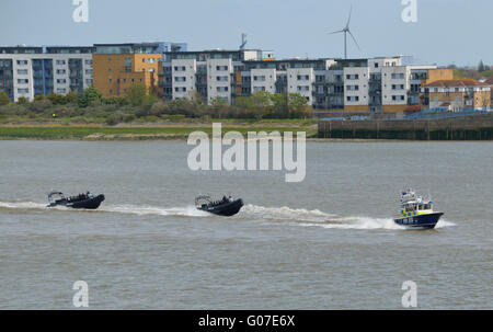 Met Police Marine Policing Unit boat  Sir Robert Peel II MP4 with two RIBs heading up the Thames in London UK - Stock Photo