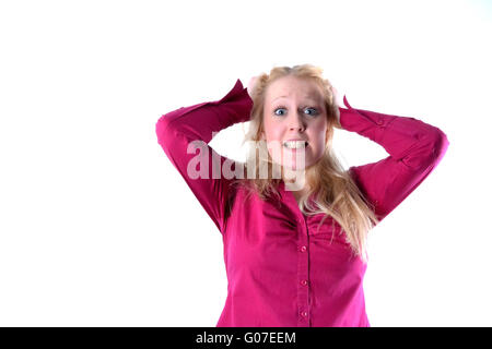 Blonde young woman who wanders through his hair - Stock Photo