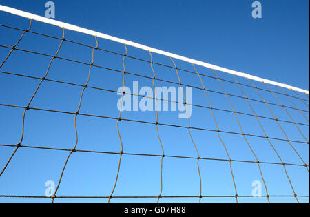 Part of volleyball net against clear blue sky - Stock Photo