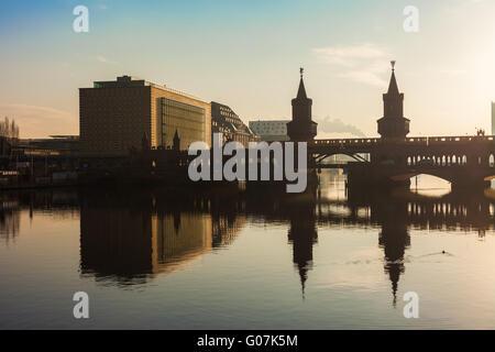 Oberbaum Bridge (Oberbaumbruecke) with River Spree, Berlin - Stock Photo