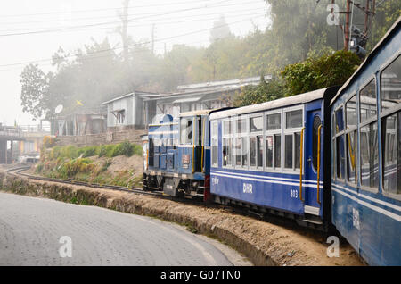 Darjeeling Himalayan Railway, Toy Train climbing a steep slope on a curve. - Stock Photo