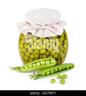 Glass jar of preserved peas and pods isolated on white - Stock Photo
