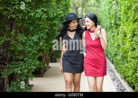 Best friends taking a walk together in outdoor park. friendship and fun time concept - Stock Photo
