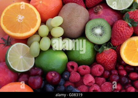Healthy fresh fruit super food background with fruits. High in antioxidants, vitamins, anthocyanins and dietary - Stock Photo