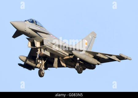 Royal Air Force Eurofighter EF-2000 Typhoon FGR4 arriving runway 31 in the late evening sun. - Stock Photo