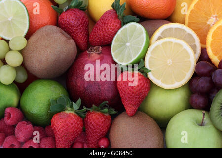 Juicy health fruit selection forming a background. High in antioxidants, vitamins, anthocyanins and dietary fiber. - Stock Photo