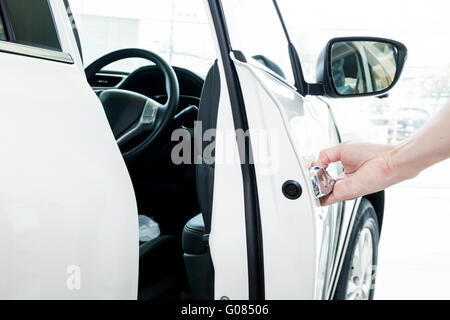 Human hands welcoming people to go chauffeur seat. - Stock Photo