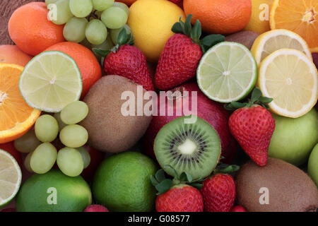 Large fresh fruit background with fruits high in antioxidants, vitamins, anthocyanins and dietary fiber. - Stock Photo
