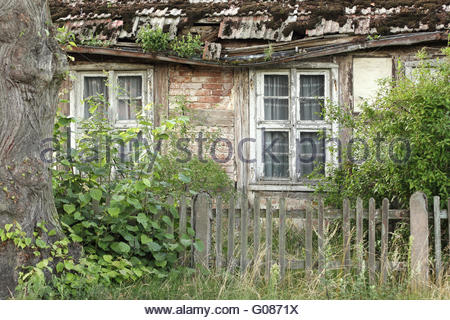 Dilapidated half-timbered house in the Uckermark - Stock Photo
