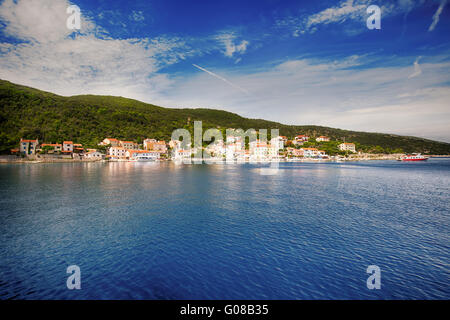 VALUN, CROATIA - August 26, 2914: View to the village Valun with harbor and boats, Cres island, Croatia - Stock Photo