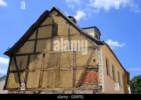 dilapidated half-timbered house in the town of Bra - Stock Photo