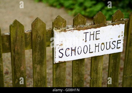Education Image Of Rustic Sign On School House Gate - Stock Photo