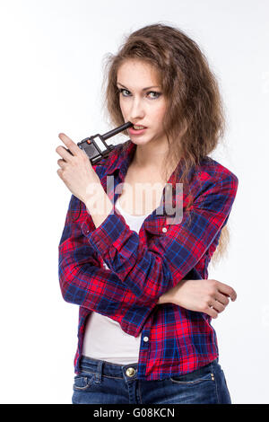 Attractive young woman in a checkered shirt with walkie talkie, - Stock Photo