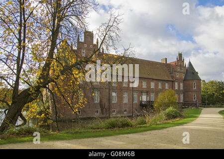 Autumnally atmosphere on the moated castle in Hert - Stock Photo
