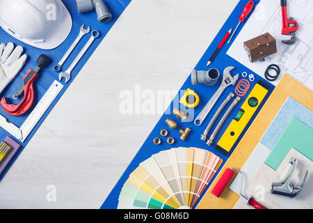 Home improvement and repair concept, plumbing work tools, tap, tiles and color swatches top view - Stock Photo