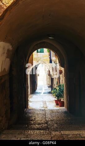 Narrow street in Old City of Jerusalem, Israel - Stock Photo